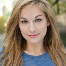 Brittany Pressley headshot blonde hair in blue shirt